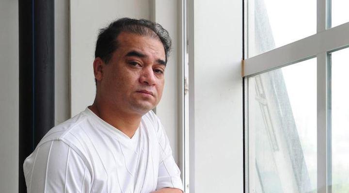Ilham Tohti, intellectuel ouïghour  et professeur à l'Université des minorités à Pékin en 2010. © Frederic J. Brown