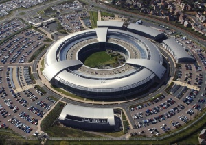 An aerial image of the Government Communications Headquarters (GCHQ) in Cheltenham, Gloucestershire. GCHQ is one of the three UK Intelligence Agencies and forms a crucial part of the UK's National Intelligence and Security machinery. The National Security Strategy sets out the challenges of a changing and uncertain world and places cyber attack in the top tier of risks, alongside international terrorism, a major industrial accident or natural disaster, and international military crisis.  GCHQ, in concert with Security Service (also known as MI5) and the Secret Intelligence Service (also known as MI6) play a key role across all of these areas and more. Their work drives the UK Government's response to world events and enables strategic goals overseas. This image is available for high resolution download at www.defenceimages.mod.uk subject to the terms and conditions of the Open Government License at www.nationalarchives.gov.uk/doc/open-government-licence/. Search for image number 45154332.jpg ------------------------------------------------------- Photographer: GCHQ/Crown Copyright Image 45154332.jpg from www.defenceimages.mod.uk For latest news visit www.mod.uk Follow us:  www.facebook.com/defenceimages www.twitter.com/defenceimages