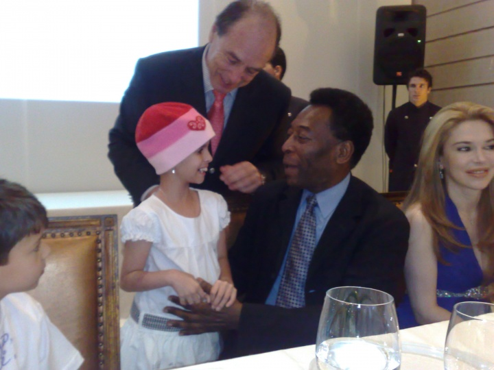 Pele greets one of the children from Little Prince Hospital