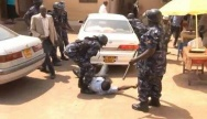 Screenshot of police beating up a journalist attached to WBS TV Uganda